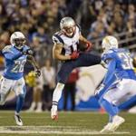 San Diego, CA 12/07/14 New England Patriots Julian Edelman making a long touchdown reception in between San Diego Chargers Brandon Flowers (#26) and Marcus Gilchrist during fourth quarter action at Qualcomm Stadium Sunday December 7, 2014. (Matthew J. Lee/Globe staff) Topic: 08patriots Reporter: