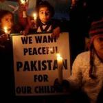 Children in Lehore, Pakistan, lit candles earlier this week  in honor of the children killed in the school attack in Peshawar.