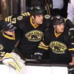 Boston--12/31/14 Bruins vs Toronto- Bruins Milan Lucic has his arms around goalie Niklas Svedberg and Brad Marchand as they watch the overtime shootout from the bench in which the Bruins lost 4-3.Boston Globe staff photo by John Tlumacki(sports)