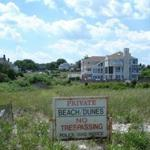 The sign warning away the public has stood for years, but Rexhame Beach has been ruled public property.