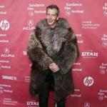 Actor Ben Mendelsohn wore a coat that his character wears in the film at the premiere of