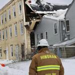 A Hingham official surveyed the damage to the since-razed Lincoln Building after its roof collapsed on Feb. 10.