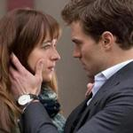 Actors Dakota Johnson, left, and Jamie Dornan appear in a scene from the film,