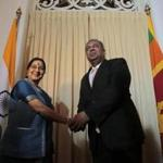 Indian Foreign Minister Sushma Swaraj shook hands with her Sri Lankan counterpart, Mangla Samaraweera, in Colombo, Sri Lanka.