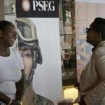 Sophia Lewis (left) of PSEG Long Island spoke with a visitor at a job fair in New York this week.
