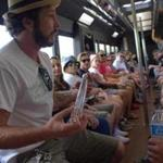 Colorado Cannabis Tours routinely fills its buses. Passengers can choose a cooking class, glassblowing demonstration, or a visit to a cultivation facility (left).