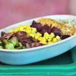 Piggery bowl features spinach, bacon, corn, pickled beets, garlic panko crumbs, and brown rice,