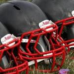 These are new football helmets that were given to a group of youth football players from the Akron Parents Pee Wee Football League in Akron, Ohio, Saturday, Aug. 4, 2012. These youth football players from low income families, are among thousands nationwide who benefit from a youth safety and helmet replacement program, partially sponsored by the NFL, to improve player safety. (AP Photo/Gene J. Puskar)