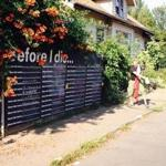 "Michael Jordan in front of his house in Portland where he's posted a ""before I die"" sign that visitors can contribute to."