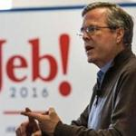 Jeb Bush likened his reaction to Iowa's results to the feeling he had eight years ago when then-senator Barack Obama prevailed. By Scott LaPierre