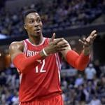 Houston Rockets center Dwight Howard (12) gestures to fans in the second half of an NBA basketball game Tuesday, Jan. 12, 2016, in Memphis, Tenn. (AP Photo/Brandon Dill)