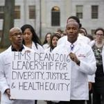 Harvard Medical School students Nelson C. Malone (left) and Danial Ceasar (right) and about three dozen classmates delivered a petition to university President Drew Gilpin Faust's office urging her to consider diversity and social justice when searching for a new medical school dean.