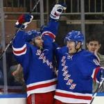 NEW YORK, NY - FEBRUARY 04: Derick Brassard #16 of the New York Rangers (l) celebrates his game winning goal at 5:46 of the third period against the Minnesota Wild and is joined by J.T. Miller #10 (r)at Madison Square Garden on February 4, 2016 in New York City. The Rangers defeated the Wild 4-2. (Photo by Bruce Bennett/Getty Images)