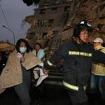TOPSHOT - Rescue personnel carry a survivor at the site of a collapsed building in the southern Taiwanese city of Tainan following a strong 6.4-magnitude earthquake that struck the island early on February 6, 2016. At least 30 people have been rescued after four buildings collapsed after a shallow quake struck at a depth of 10 kilometres (six miles) around 2000 GMT Friday, according to the US Geological Survey, 39 kilometres northeast of Kaohsiung, the second-largest city on the island and an important port. / AFP / Johnson LiuJOHNSON LIU/AFP/Getty Images