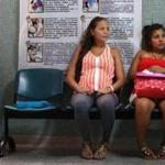 Windy Gelvez Mandón, center, 21, worried about the Zika virus waits to be checked at the Hospital Universitario Erasmo Meoz in Cúcuta, Colombia, on February 4, 2016. Mandón, in her final trimester, is worried about the possibility that her baby might also become infected.
