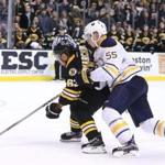 Sabres defenseman Rasmus Ristolainen (right) grabbed Bruins forward Brad Marchand in overtime, stopping a breakaway. Referees called for a penalty shot, however, and Marchand scored the winning goal.