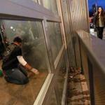 Workers cleaned the closed Chipotle restaurant in Cleveland Circle on Dec. 8.