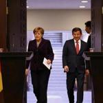 German Chancellor Angela Merkel (left) and Turkish Prime Minister Ahmet Davutoglu arrived for a joint news conference in Ankara, Turkey, Monday.