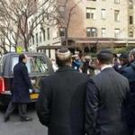 Mourners followed a hearse in front of a New York synagogue on Sunday. Funeral services were held for David Wichs, 38, a Harvard University graduate who was killed Friday by a collapsing crane in Manhattan.