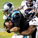 DeMarcus Ware wrapped up Panthers quarterback Cam Newton for one of his two sacks.