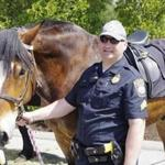 Plymouth Police Sergeant Raymond Reid and Big John the horse. Big John, a 7-year-old Belgian-Clydesdale on the Plymouth Police Department's mounted unit, was? recently? diagnosed with a rare autoimmune disorder. A GoFundMe page has been set up to raise money to cover the costs of his treatment and recovery. (Plymouth Police Sergeant Raymond Reid)
