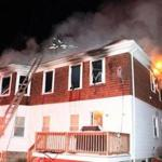A two-alarm fire at a Fitchburg home killed one woman early Wednesday, officials said.