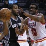 Spurs forward Kawhi Leonard passed around Heat forward Amar'e Stoudemire during the second half.