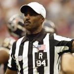 HOUSTON - NOVEMBER 23: Referee Mike Carey #94 calls a penalty during the game between the Houston Texans and the New England Patriots on November 23, 2003 at Reliant Stadium in Houston, Texas. The Patriots defeated the Texans 23-20 in overtime. (Photo by Ronald Martinez/Getty Images) Library Tag 12102006 Sports
