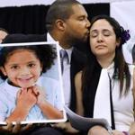Jimmy Greene kissed his wife Nelba Marquez-Greene as he held a portrait of their daughter, Sandy Hook School shooting victim Ana Marquez-Greene last December.