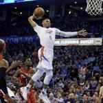 Feb 11, 2016; Oklahoma City, OK, USA; Oklahoma City Thunder guard Russell Westbrook (0) dunks the ball against the New Orleans Pelicans during the third quarter at Chesapeake Energy Arena. Mandatory Credit: Mark D. Smith-USA TODAY Sports