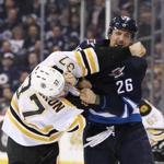 WINNIPEG, MB - FEBRUARY 11: Patrice Bergeron #37 of the Boston Bruins and Blake Wheeler #26 of the Winnipeg Jets fight in second period action in an NHL game at the MTS Centre on February 11, 2016 in Winnipeg, Manitoba, Canada. (Photo by Marianne Helm/Getty Images)