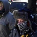 Boston, MA - 2/14/2016 - Evan Mestre, 12, and his sister Angelinne, 16, (L) of Miami, Florida bundled up against the cold as they waited for the light to change in Boston, MA February 14, 2016. Jessica Rinaldi/Globe Staff Topic: 15cold Reporter: