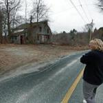 03/24/16: Dudley, MA: Dudley resident Desiree Moninski is pictured walking across the street from her house to the site where the Islamic Society of Greater Worcester wants to build a Muslim Cemetery. (Globe Staff Photo/Jim Davis) section:metro topic:26cemeterys1
