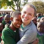 Jillian Bowdring of Lexington shares a special moment during a trip to Tanzania with Thomson Family Adventures.