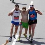 Jim Driscoll (right) and Mitch Kies (left) helped Ari Ofsevit across the finish line of Monday's Boston Marathon.