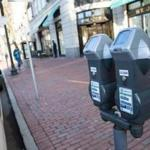 Parking meters line the street on Boylston Street in Boston.