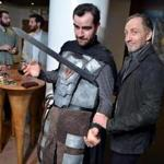 "Michael McElhatton, a.k.a. Roose Bolton (right), hammed it up with fan Ryan Stewart of Boston, dressed as GoT character Stannis Baratheon, at a viewing party for the ""Game of Thrones'' premiere at the Revere Hotel."