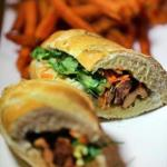 Banh mi sandwich with lemongrass chicken and sweet potato fries.