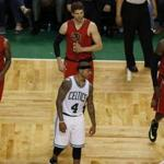 Boston, MA - 4/28/2016 - Boston Celtics Isaiah Thomas (C) walks back in after a break in play in front of Atlanta Hawks (L-R) Jeff Teague, Kyle Korver and Paul Millsap during the fourth quarter of Game 6 at TD Garden in Boston, MA April 28, 2016. Jessica Rinaldi/Globe Staff Topic: Reporter: