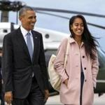 FILE - In a Thursday, April 7, 2016 file photo, President Barack Obama jokes with his daughter Malia Obama as they walk to board Air Force One from the Marine One helicopter, as they leave Chicago en route to Los Angeles. The White House announced Sunday, May 1, 2016, that Malia Obama will take a year off after high school and attend Harvard University in 2017. (AP Photo/Jacquelyn Martin, File)