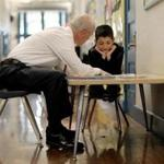 At the John Winthrop Elementary School, volunteer mentor Rob Lyons of Natixis worked Wednesday with student Angel Laboy.