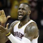 Cleveland Cavaliers forward LeBron James (23) reacts in the first half against the Atlanta Hawks during Game 2 of a second-round NBA basketball playoff series, Wednesday, May 4, 2016, in Cleveland. (AP Photo/Tony Dejak)