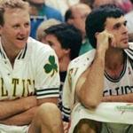 ** FILE ** Boston Celtics, from left, Robert Parish, Larry Bird, and Kevin McHale watch their team win over the Washington Bullets at the Boston Garden, in Boston, in this Nov. 30, 1991, file photo. Don't call them the Big Three yet. Paul Pierce, Kevin Garnett and Ray Allen aren't at the level of Larry Bird, Kevin McHale and Robert Parish when they led the Celtics to championships in the 1980s. But the new trio of stars would move Boston much closer to a shot at an NBA title. (AP Photo/Stephan Savoia, File)