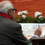 Joel Blanc paints at the 2016 French Open in May. Credit: