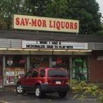 Sav-Mor Liquors adds a sign aimed at McDonald's to its Medford location.