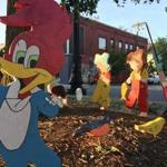 A Woody Woodpecker ornament and other wood cutouts have appeared on a traffic island in Somerville.