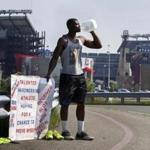Foxborough. Ma- May 25, 2016-Globe Staff Photo by Stan Grossfeld-Abiola Aborishade of Attleboro a former Division III star receiver at UMASS Dartmouth has been standing outside Gillette Stadium almost every day since April 21st. looking for a tryout from the Patriots.
