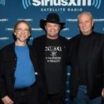 From left to right: Peter Tork, Micky Dolenz, and Michael Nesmith of The Monkees in May.