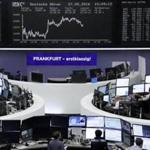 Traders worked at their desks in front of the German share price index at the Frankfurt stock exchange last week.