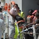 Women rescued in the Mediterranean Sea arrived aboard an Italian navy ship in the port of Reggio Calabria on Sunday.